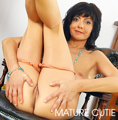 Brunette Eastern European Mature Spreads Her Legs